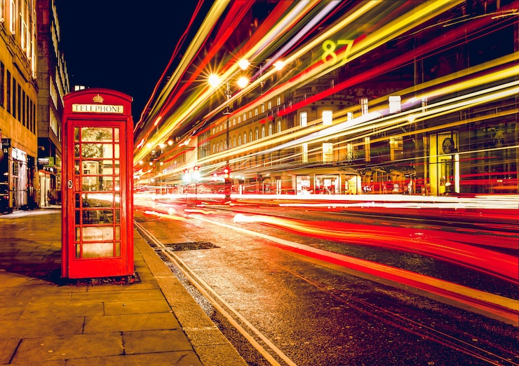 London's red telephone booth with traffic jam hyperlapsed